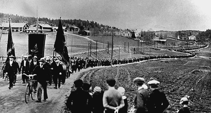 A seemingly endless line of marchers mobilize for economic justice for poverty-stricken workers in Ådalen, Sweden, in 1931.