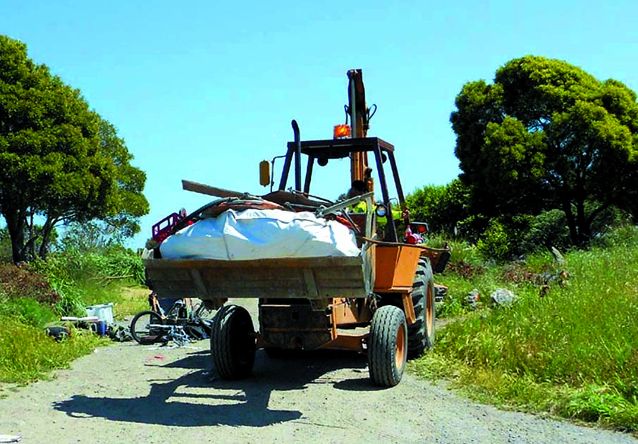 Bulldozer.jpg Albany officials sent in bulldozers and haulers to demolish the homes and destroy the belongings of scores of homeless people at the Albany Bulb. Lydia Gans photo